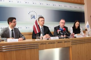 Latvian Finance Minister Andris Vilks and Mark Griffiths.