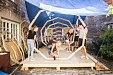 Estonian students construct wooden installation consisting of three giant megaphones