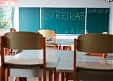 Lithuanian teachers stage warning strike